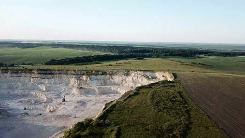 Aerial view of open quarry - top view. quarries for construction with blue sky. mineral environment, industry. rural landscape