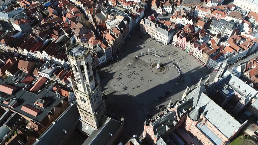 Aerial static footage of Belfry of Bruges in Dutch Belfort van Brugge and Market Square Markt the Belfry is medieval bell tower in centre of Bruges Belgium one of the citys most prominent symbols 4k