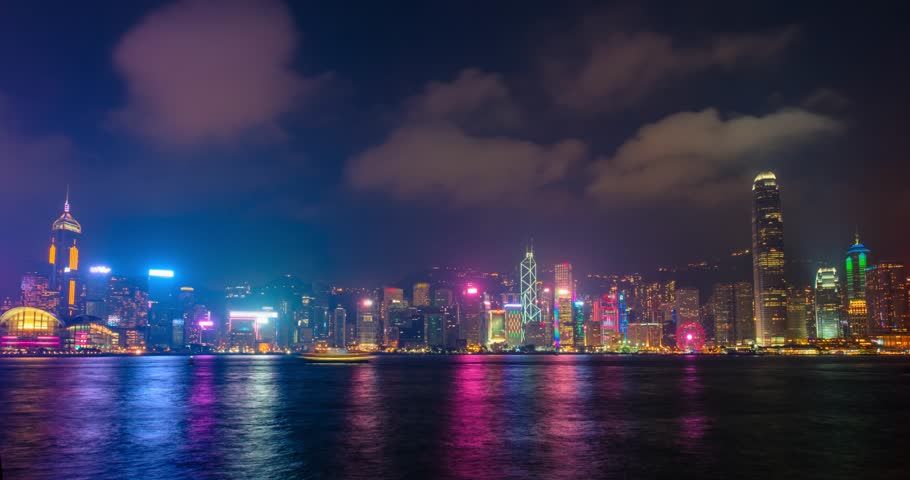 Night timelapse of illuminated Hong Kong skyline cityscape downtown skyscrapers over Victoria Harbour in the evening. Hong Kong, China | Shutterstock HD Video #1012155032