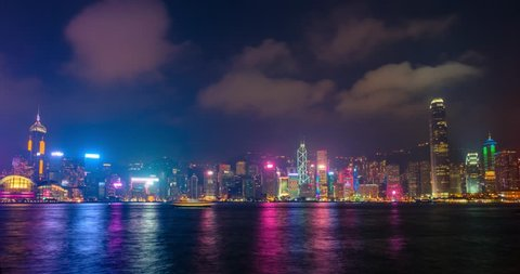 Night timelapse of illuminated Hong Kong skyline cityscape downtown skyscrapers over Victoria Harbour in the evening. Hong Kong, China