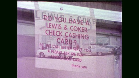 1970s: man collects checks from lewis and clark grocery store counter   oldsmobile cutlass drives past handy andy sign  guy walks in parking lot   customer gets slips from window  car rides to kroger