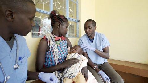 Doctors working in neonatal clinic. Kenya.