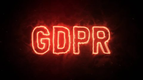 Personal data protection GDPR text symbol in hot fire on black background