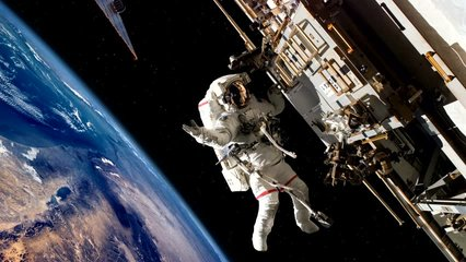 4K Astronaut outside the International Space Station on a spacewalk with a dramatic view of the Earth rotating in the background. Perfect for videos about:4K, NASA, Astronauts, spacewalk, ISS, 2160
