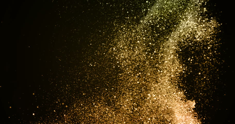 christmas golden gradient sparkle glitter explosion dust particles background with bokeh flowing falling down in slow motion, holiday happy new year and valentine day love, relationship