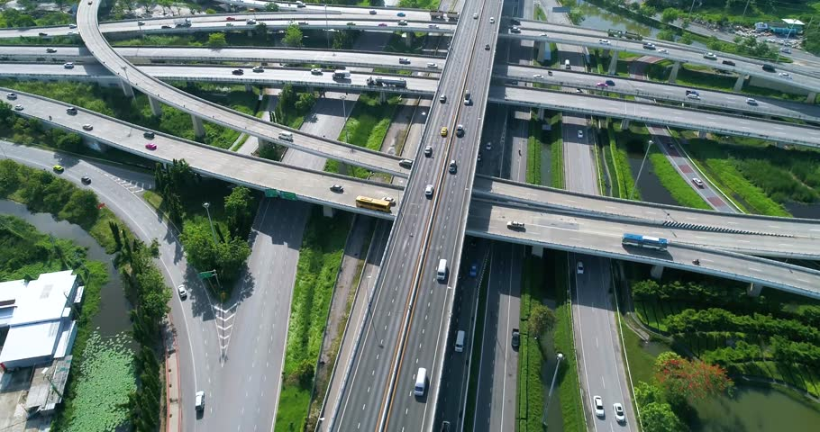Aerial view, top down view of traffic jam on a car bridge and moving train. 4K video