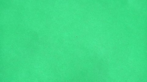 Sand falling on a green screen background pattern