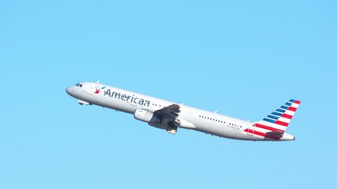 ORLANDO, FL - 2018: American Airlines Airbus A321-200 Commercial Jet Airplane Taking Off into a Blue Sky Departing from MCO McCoy International Airport on a Sunny Day in Florida