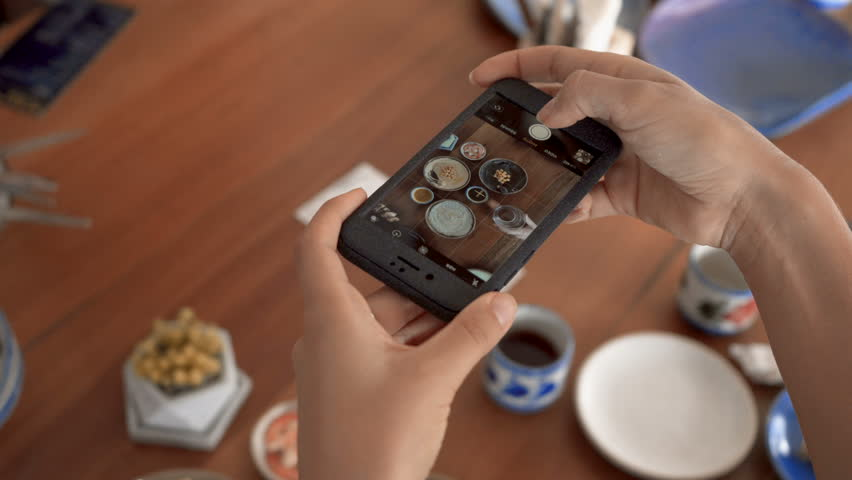 Take a photo of food in a restaurant with mobile phone camera for social network | Shutterstock HD Video #1012294802