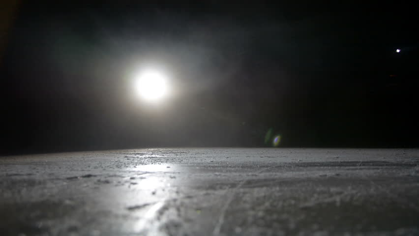 Hockey player make ice sparkles on high speed braking in dark on arena | Shutterstock HD Video #1012309292