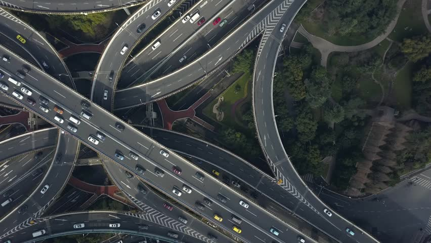 Aerial Top epic multilevel Road traffic Junction Shanghai China Overpass complicated urban transportation cars interchange complex Technology unique modern technological construction urban. Drone