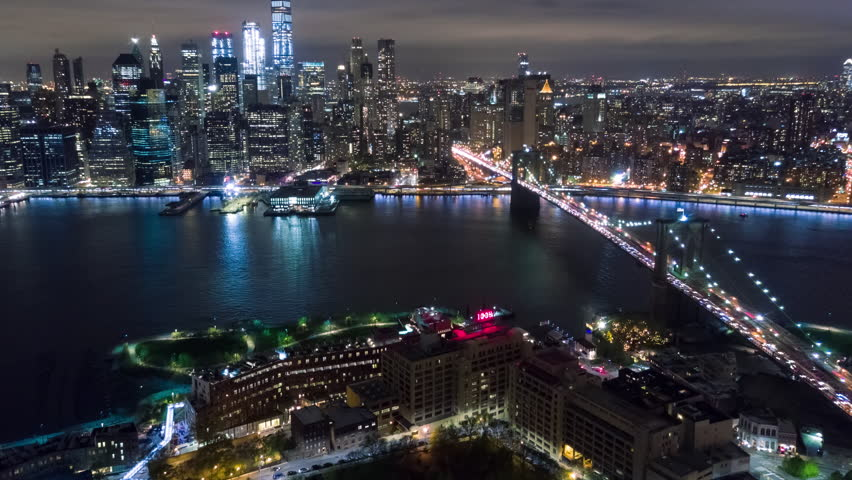 Aerial night view of Manhattan, New York City. Tall buildings. Timelapse dronelapse. NY from above. | Shutterstock HD Video #1012402202