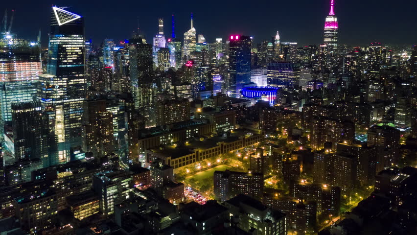 Aerial night view of Manhattan, New York City. Tall buildings. Timelapse dronelapse. NY from above. | Shutterstock HD Video #1012402232