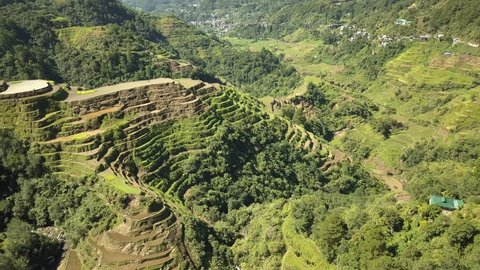 Aerial drone view circling around the huge, famous Banaue Rice Terraces in Luzon, Philippines