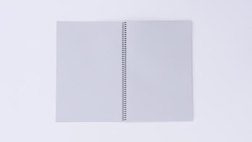 Turning page binder book by wind on a white background