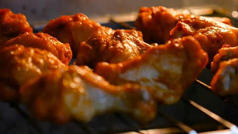 Baking hot and spicy grill chicken wings in the oven with grain processed