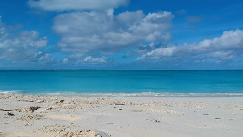 Drone ascending aerial of beach in Grace Bay, Providenciales, Turks and Caicos