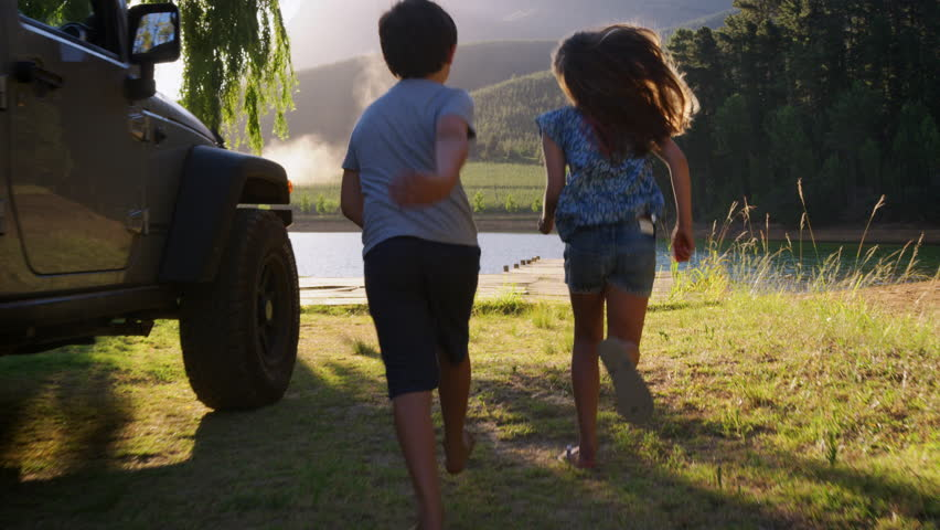Kids run to join parents admiring view on jetty, slow motion | Shutterstock HD Video #1012449332