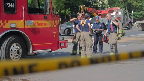 ST. GEORGE & BLOOR ST, TORONTO, CANADA - CIRCA JUNE 2018: Police, firemen, & emergency vehicles at a fatal crime scene accident. The street is cleaned and investigated by local authorities
