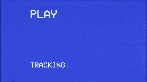 An old bad broken VHS tape playing. Blue screen, sixteen-nine factor, with PLAY and TRACKING text. A vintage background for videos, a retro element.