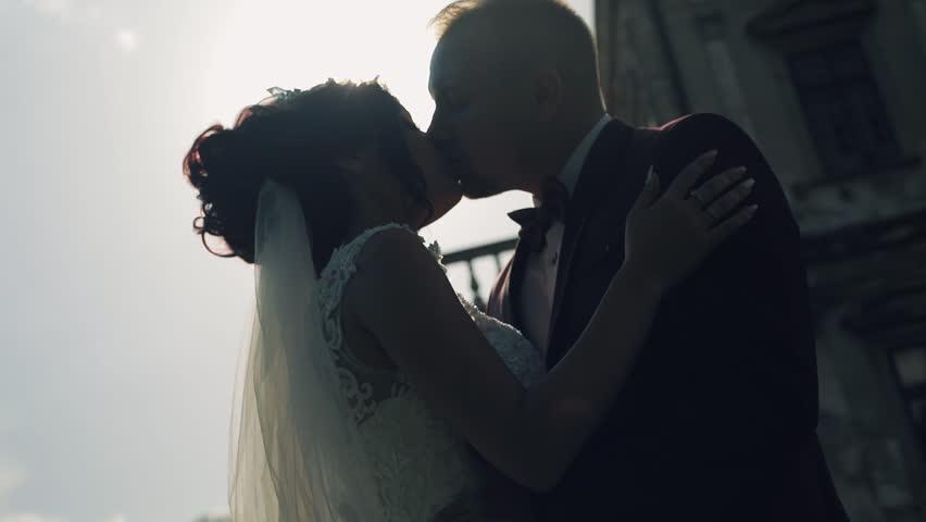 Lovely wedding couple making a kiss | Shutterstock HD Video #1012519022