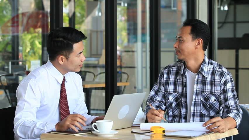Business partner marketing discussing market research and brainstorming with colleagues in a meeting.T | Shutterstock HD Video #1012556072