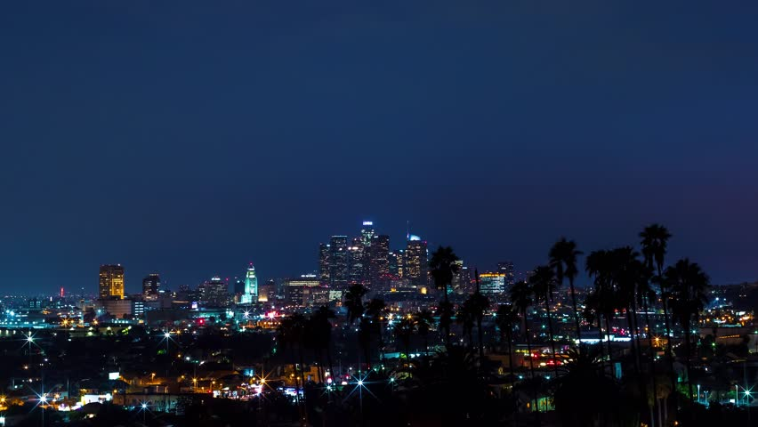 Sunrise time-lapse of Downtown Los Angeles with palm trees