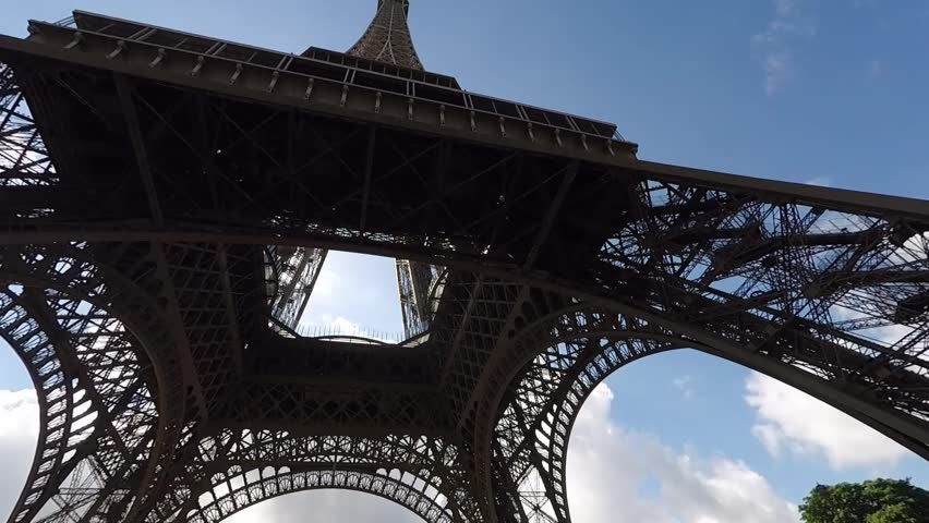 Shot from underneath the Eiffel Tower in Paris, France. | Shutterstock HD Video #1012587902