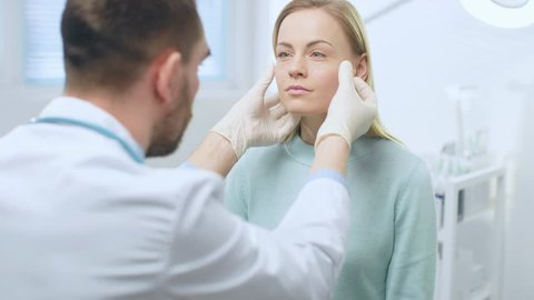 Plastic / Cosmetic Surgeon Examines Beautiful Woman's Face, Touches it with Gloved Hands, Inspecting Healed Face after Plastic Surgery with Amazing Results. Shot on RED EPIC-W 8K Helium Cinema Camera.