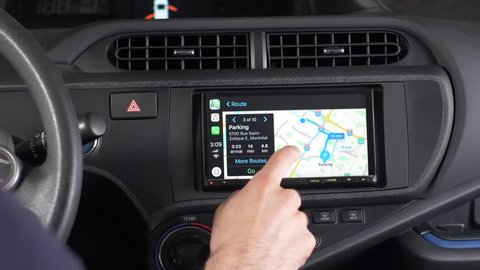 MONTREAL, CANADA - June 2018 :  a car touchscreen, using the navigation GPS maps of Apple CarPlay