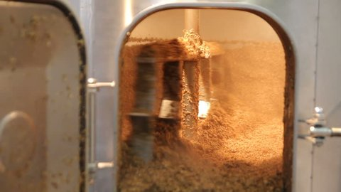 Brewing. Mixing of malt in the brewing tank. Used malt after brewing process.