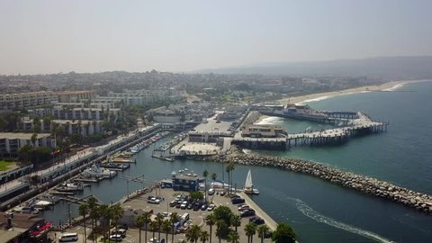 Redondo Beach California pier, shopping area and harbor with jetty from an aerial perspective