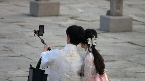 People Walking in Traditional Korean Costume Hanbok Taking Selfie in South Korea