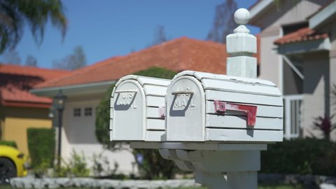 White US mailbox with a red flag in a suburban neighborhood - Florida, United States