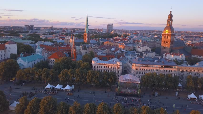 "Aerial view of the Riga old town celebrating ""Jani"" with people dancing and singing in the center of Riga by the sunset. 