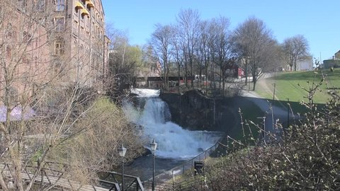 """The largest waterfall of the Akerselva River in Oslo is the one near the cottage known as """"Hønse-Lovisas hus"""", a small red house near the Beier bridge. Flat profile video"""