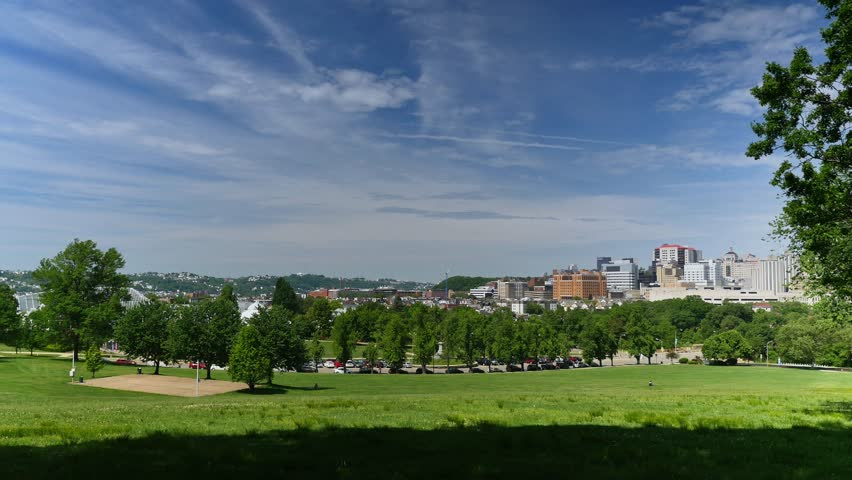 A wide angle establishing shot of Oakland and the city of Pittsburgh, as seen from Schenley Park.