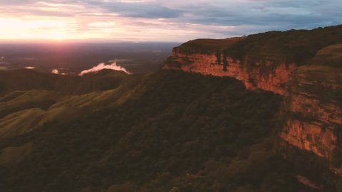 Aerial view of the clouds by the mountains at sunset in Chapada dos Guimaraes - Brazil
