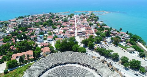 Aerial copter flight to old historic Antique Theater in Side, Turkey. Aerial view city of Side, Antalya.