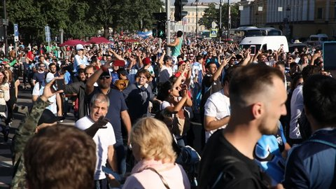ST. PETERSBURG, RUSSIA - JUNE 25, 2018: Argentinian football fans singing on the streets of Saint-Petersburg on the day before FIFA World Cup 2018 match Argentina vs Nigeria