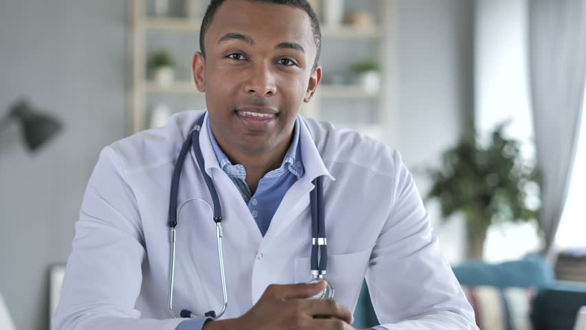 African-American Doctor Talking with Patient, Video Chat