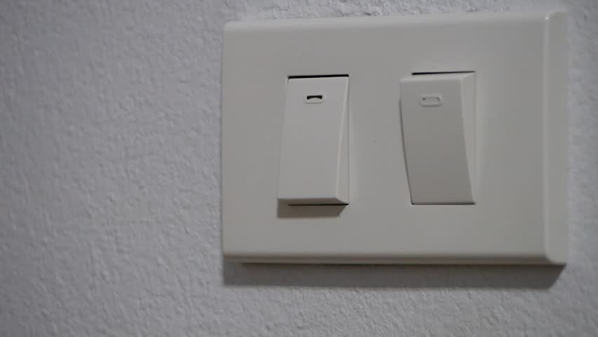Close the room light switch with close up view | Shutterstock HD Video #1012813892