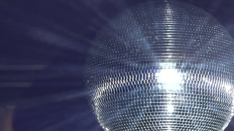 Rotating disco mirror ball. Rotating sparkling disco ball. Concept of night party.