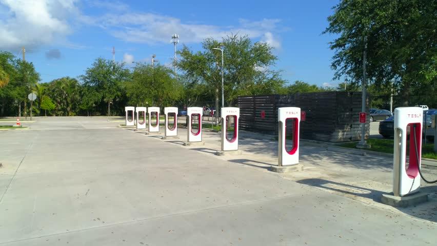 WEST PALM BEACH, FL, USA - JUNE 24, 2018: Tesla supercharger West Palm Beach Florida cinematic motion video 4k 60p | Shutterstock HD Video #1012865162