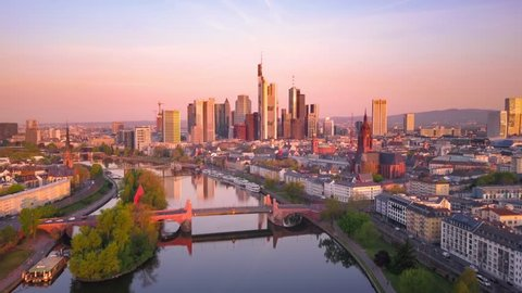frankfurt aerial view at dawn flight backwards over main river business center in the background
