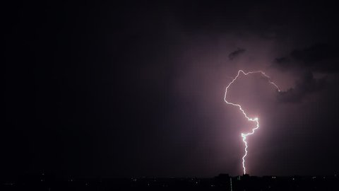 Night stormy sky above city. Set of beautiful lightning strikes. Thunderstorm clouds. Timelapse. Slow motion.