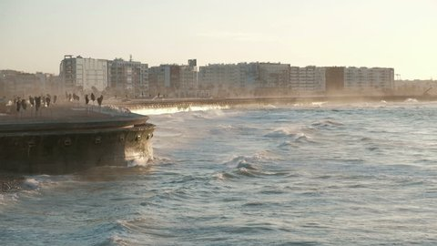 Camera still view of waves breaking along the newly built waterfront promenade in late afternoon in Casablanca, Morocco