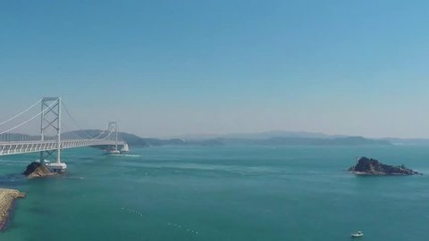 Naruto bridge and whirlpool viewing boats time lapse, Tokushima Japan.