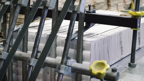 Printing Press. close up on books magazines being folded mechanically on a conveyor
