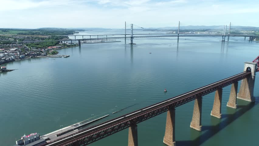 4K aerial footage of the iconic Victorian cantilever railway bridge across the Firth of Forth near Edinburgh. | Shutterstock HD Video #1012948682